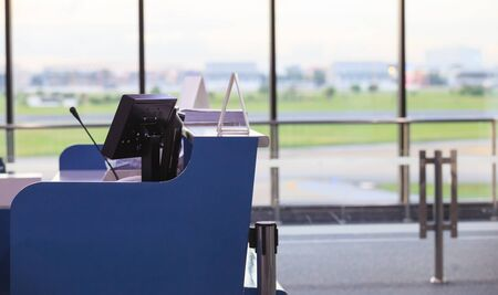 Service Counter for Airline Gate Agents, Stewards, Stewardesses or Ground Attendants in front of a boarding gate in an airport. Business Travel, Workplace, Transportation Industry and Service concept Foto de archivo