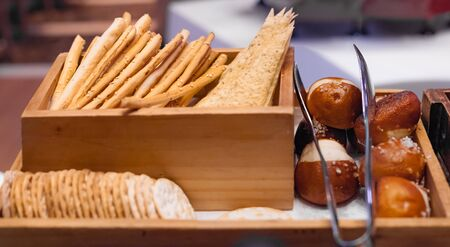 Farmhouse Freshly Baked Italian Styled Breadsticks (Grissini Bread), pencil-sized sticks of crisp, dry baked bread. Food Staple from natural organic ingredient, healthy meal. Daily Nutrition Concept. Foto de archivo