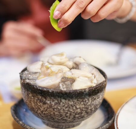 Selective Focused Thai Fresh Seafood: fresh delicious oysters served on ice, eat raw with freshly squeezed lime juice. Nutrition, Food , Cuisine, Thai Traditional Dish and Thailand Gourmet concept