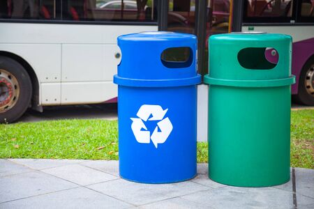 Blue Recycling Bin collects recyclables or recycled material like glass bottles, jars, cartons, plastic bottles and cans. Green Bin is for household organic waste. Waste Separating or Sorting concept Foto de archivo
