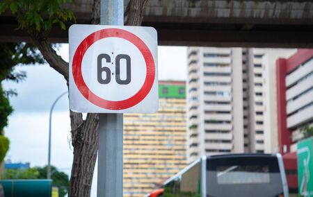 Metal Plate Traffic Sign: Speed limit 60 sign is usually shown as black number in red circle on white rectangular background. It is maximum speed applicable on any road expressed as km or mile per hr