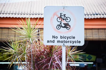 No Bicycle and Motorcycle Traffic sign keeps cyclists from pedestrian areas and playgrounds. Prevent bikes and motorbike from overrunning pedestrian malls or endangering children by setting the rules