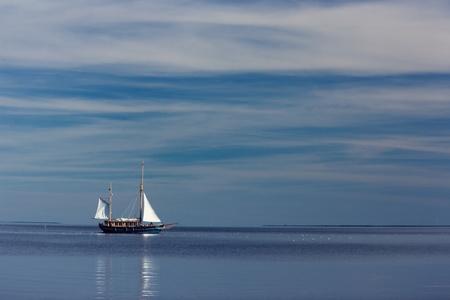Lonely sailboat at sea Stock Photo