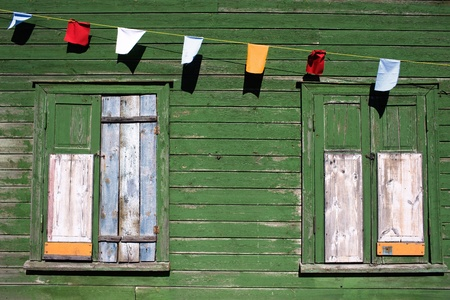 creditors: Boarded-up windows on a holiday