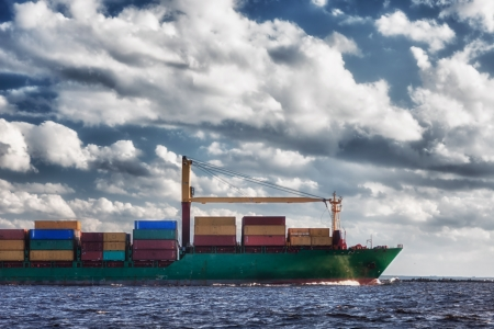 Ship with containers out into the open sea