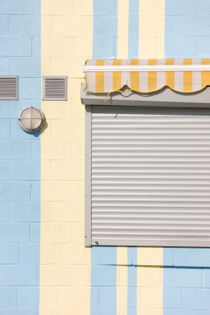 Roller shutters on the facade of the house