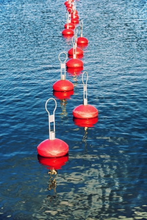 Red buoy for mooring boats on the water Stock Photo