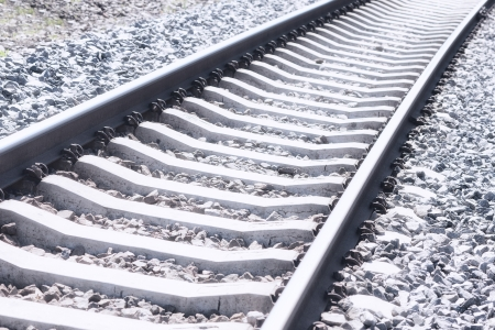 Railroad tracks and a mound of stones Stock Photo