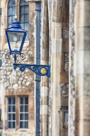 Street lamp on the wall of a house in London photo