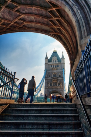 Couple of tourists goes to the Tower Bridge in London Editorial