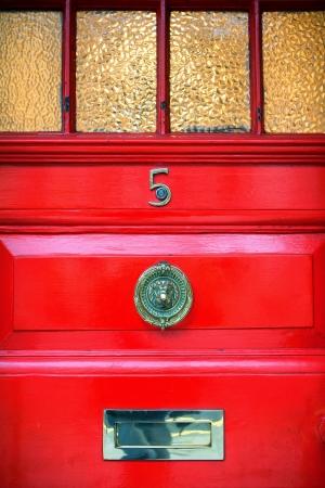 The red front door in England photo