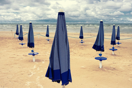 Closed umbrellas on the beach of the Baltic Sea