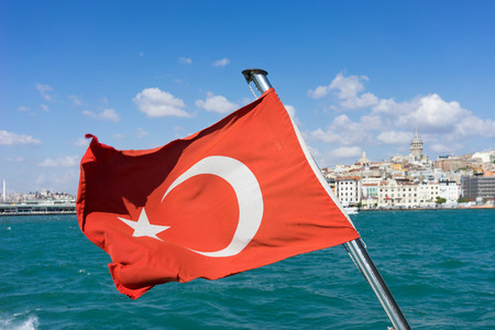View of Istanbul from the ferry with a flag in the wind Stock Photo