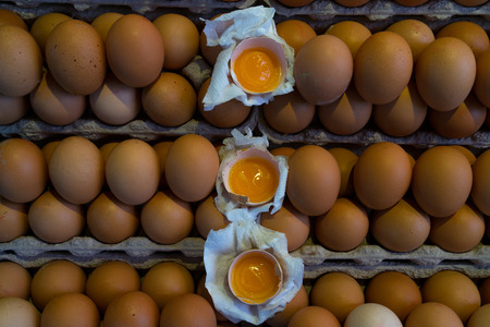 Yellow eggs with yolk in the market in rhythmic series Stock Photo