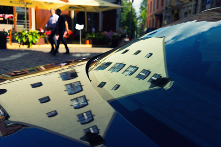 Old houses reflected in a modern car. Riga. Latvia. Summer Stock Photo