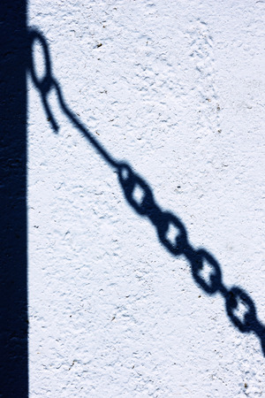 The shadow of the chain link fence on the wall. Latvia photo
