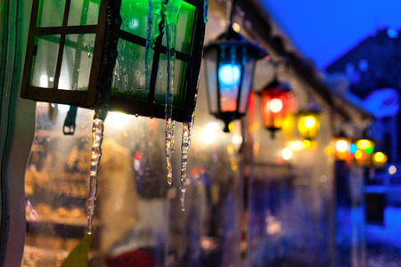 Multicolored lights in icicles at the fair in town for Christmas and New Year. Riga, Latvia