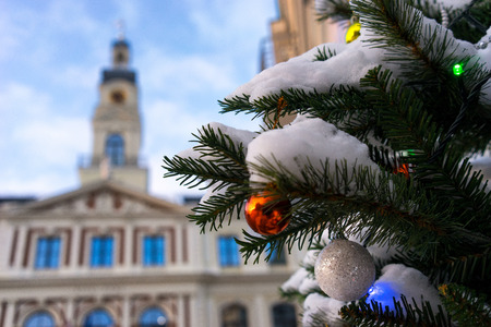 Town hall of Riga and Christmas tree with colorful balls. Vecriga, Latvia