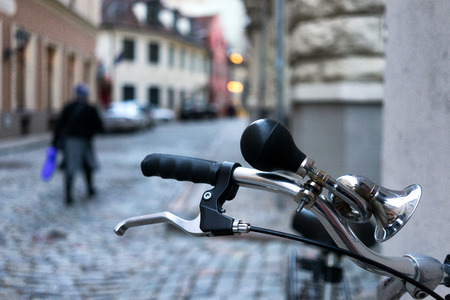 Wheel bicycle with a horn on the streets of the old city background Stock Photo