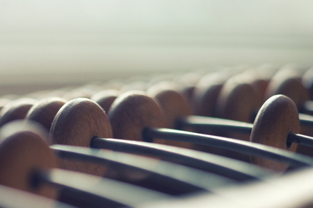 Old wooden abacus on the rods for arithmetic operations Stock Photo