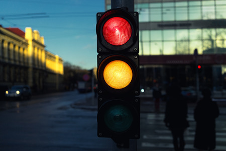 Traffic lights at an intersection at a pedestrian crossing on a winter evening
