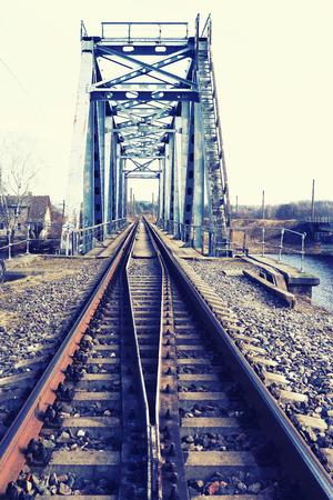 Steel railway bridge across the river with the rails. Latvia