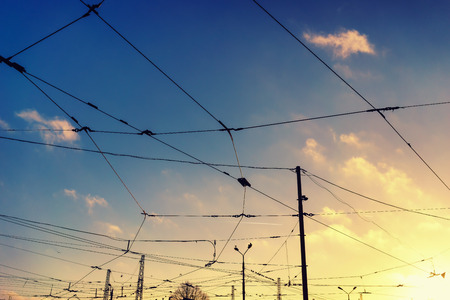 conductor electricity: Evening autumn blue sky with clouds at sunset with wires