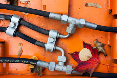 adapters: Hoses with metal adapters on an orange background with autumn leaves Stock Photo