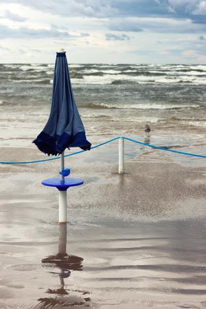 jurmala: Beach umbrella from the sun in the storm at sea. Jurmala. Latvia