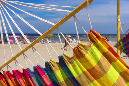 jurmala: Colored hammock on a beach on a background of blue sky Stock Photo