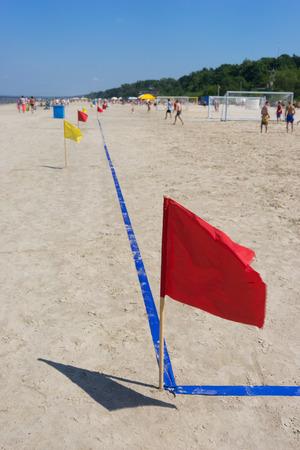 jurmala: Red flag on the football pitch on the beach. Jurmala. Baltic sea Stock Photo