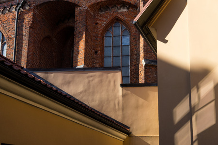 classic contrast: Contemporary wall of the house on the background of the church Stock Photo