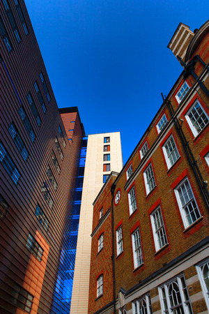 The geometry of the beautiful facades of buildings in London against the blue sky