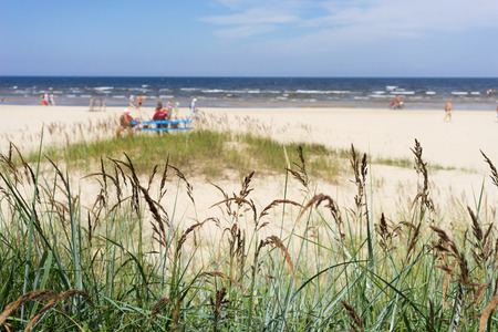 jurmala: The sandy beach of the Baltic Sea on a summer day season with vacationers people. Latvia, Jurmala