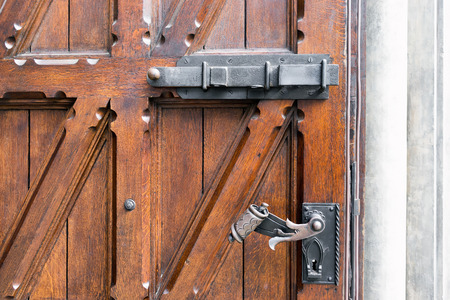 Massive wooden doors with wrought old castle and a reliable lock Stock Photo - 40861279 & Massive Wooden Doors With Wrought Old Castle And A Reliable Lock ... pezcame.com