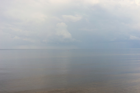 meditative: Meditative calm on the Baltic Sea with a red and blue buoy horizon before rain