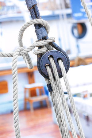 Ropes and wooden fixing arrangements on a large sailboat