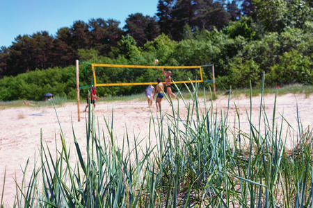 The men playing volleyball on the beach of the Baltic Sea in the dunes in the summer Stock Photo