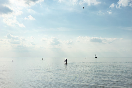 baltic people: People walk on the Baltic Sea in a calm sunny summer day. Latvia