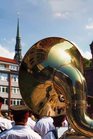 church steeple: Riga. Latvia. Reflection of Riga in a large copper pipe musicians on the background of the church steeple with a cockerel