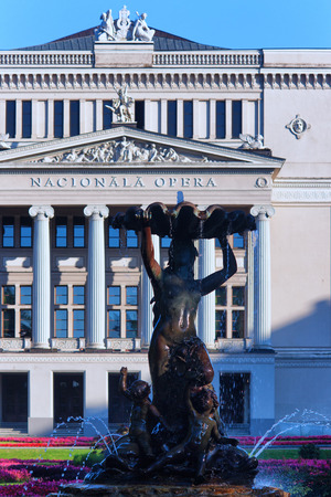 angels fountain: Fountain woman with flowers and angels in the building of the Latvian National Opera in Riga with columns