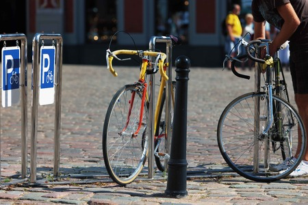 town hall square: Public parking for bikes at the Town Hall Square in the city center on a sunny summer day Stock Photo