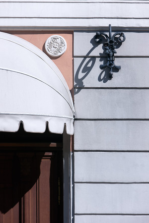 marquise: Detail of the facade of an old house with a marquise over the door and decorations Stock Photo