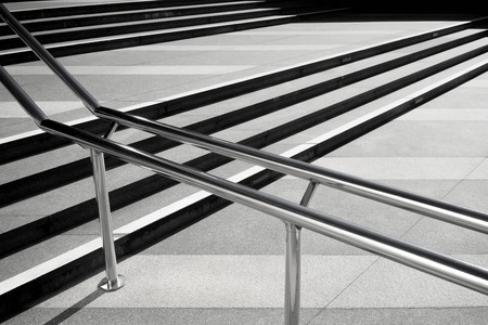 long term: Lines of steps of the staircase in the long term and steel railing with shadow