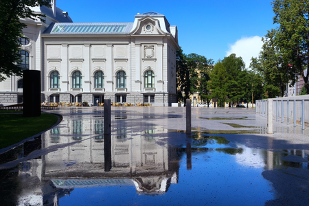 The building of the renovated National Museum of Art in Riga with reflection in puddles after rain Editorial
