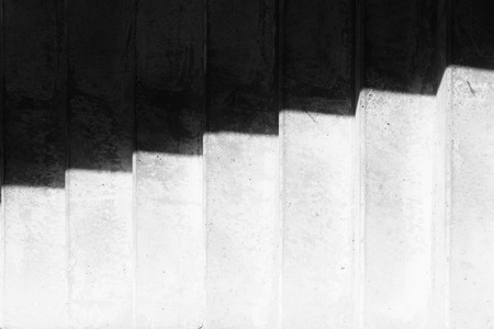 black shadow: Shadow on concrete stairs step by step going up Stock Photo
