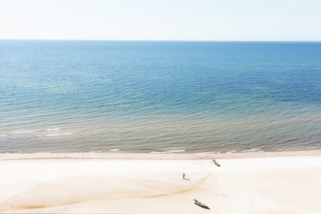 Top view of the Baltic sea with fishing boats on the yellow sandy beach of Latvia