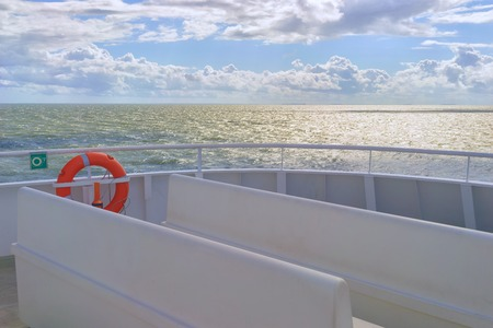 A look at the Baltic Sea from the deck of a passenger ferry on a sunny day with clouds Stock Photo