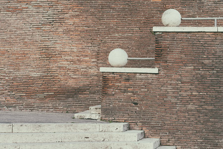 Staircase with balls in a brick wall in the city of Rome