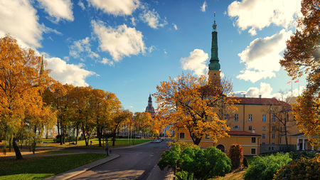Panorama of the Presidential Palace and the Dome Cathedral among the yellow autumn trees in Riga in the autumn on a sunny day Фото со стока